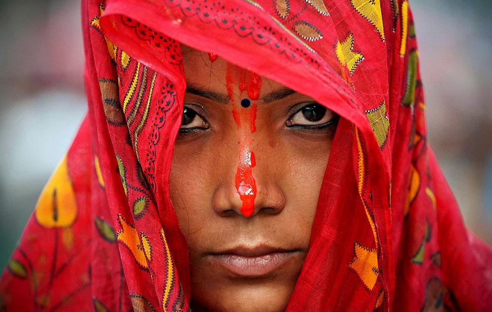 Nepalese Hindu devotee looks on while praying